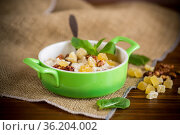 cooked boiled sweet oatmeal with nuts and candied fruits in a bowl. Стоковое фото, фотограф Peredniankina / Фотобанк Лори