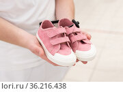 pink children's sneakers in the men's hands. Стоковое фото, фотограф Володина Ольга / Фотобанк Лори