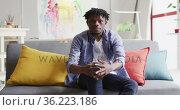 Portrait of african american male artist sitting on the couch at art studio. Стоковое видео, агентство Wavebreak Media / Фотобанк Лори