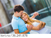 Adolescent teen couple together laughing very happy. Стоковое фото, фотограф Emil Pozar / age Fotostock / Фотобанк Лори