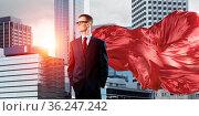 Young confident businessman wearing red cape against modern city background... Стоковое фото, фотограф Zoonar.com/Aleksandr Khakimullin / easy Fotostock / Фотобанк Лори