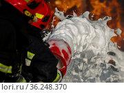 Firefighter puts out a fire. Silhouettes of firefighters with hoses... Стоковое фото, фотограф Zoonar.com/Svetlana / easy Fotostock / Фотобанк Лори