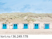 Little white blue cabins at the beach of Texel. The largest wadden... Стоковое фото, фотограф Zoonar.com/Hilda Weges / easy Fotostock / Фотобанк Лори