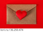 Valentine day love letter, envelope of craft paper with red heart... Стоковое фото, фотограф Zoonar.com/Ivan Mikhaylov / easy Fotostock / Фотобанк Лори