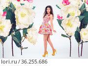 Concept fashion portrait of young beautiful woman with oversized flowers... Стоковое фото, фотограф Zoonar.com/Svetlana Radayeva / easy Fotostock / Фотобанк Лори