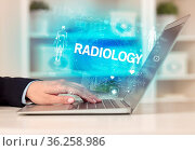 Doctor working a health check with RADIOLOGY inscription, recording... Стоковое фото, фотограф Zoonar.com/rancz / easy Fotostock / Фотобанк Лори