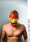 Emotional football fan with spain flag painted on his face over gray... Стоковое фото, фотограф Zoonar.com/Svetlana Radayeva / easy Fotostock / Фотобанк Лори