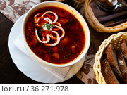 Traditional Russian meat soup solyanka with assorted meat and sausages and vegetables. Стоковое фото, фотограф Яков Филимонов / Фотобанк Лори
