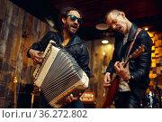 Artists with accordion and balalaika, rock band. Стоковое фото, фотограф Tryapitsyn Sergiy / Фотобанк Лори
