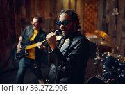 Two brutal musicians, music performing, rock band. Стоковое фото, фотограф Tryapitsyn Sergiy / Фотобанк Лори