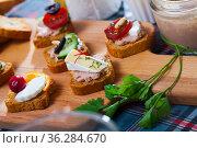 Assorted homemade canape appetizers. Стоковое фото, фотограф Яков Филимонов / Фотобанк Лори