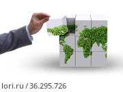 Businessman building world map from cubes. Стоковое фото, фотограф Elnur / Фотобанк Лори