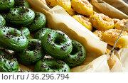Doughnuts with colorful frosting. Стоковое фото, фотограф Яков Филимонов / Фотобанк Лори
