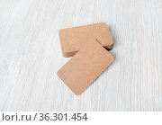 Photo of blank kraft business cards on light wood table background... Стоковое фото, фотограф Zoonar.com/Alex Veresovich / easy Fotostock / Фотобанк Лори
