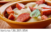 Crockpot Pierogi Casserole with Kielbasa, frozen ravioli and chicken... Стоковое фото, фотограф Zoonar.com/MYCHKO / easy Fotostock / Фотобанк Лори