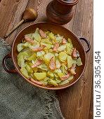 Polish Cabbage, Potato, and Bacon Casserole. close up. Стоковое фото, фотограф Zoonar.com/MYCHKO / easy Fotostock / Фотобанк Лори