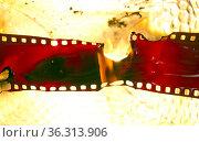 Old 35 mm film melting. Стоковое фото, фотограф Zoonar.com/charles taylor / easy Fotostock / Фотобанк Лори
