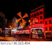 PARIS - JULY 1: The Moulin Rouge by night, on July 1, 2013 in Paris... Стоковое фото, фотограф Zoonar.com/Andrey Omelyanchuk / age Fotostock / Фотобанк Лори