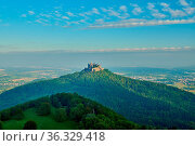Hilltop Hohenzollern Castle on mountain top in Swabian Alps, Baden... Стоковое фото, фотограф Zoonar.com/NIKOLAY OKHITIN / easy Fotostock / Фотобанк Лори
