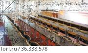 Digital composition of mathematical equations and formulas floating against empty classroom. Стоковое фото, агентство Wavebreak Media / Фотобанк Лори