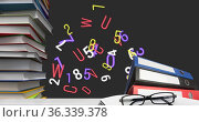 Digital image of glasses and stack if books against multiple numbers and alphabets floating on b. Стоковое фото, агентство Wavebreak Media / Фотобанк Лори