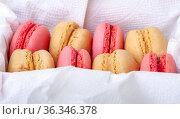 Macaroni cakes with vanilla and strawberry filling in a box. Gourmet dessert. Стоковое фото, фотограф Анна Гучек / Фотобанк Лори
