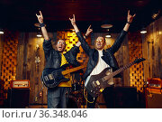 Two artists with electric guitars, rock band. Стоковое фото, фотограф Tryapitsyn Sergiy / Фотобанк Лори