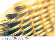 Stack of golden coins macro. Rows of coins for finance and banking... Стоковое фото, фотограф Zoonar.com/BASHTA / easy Fotostock / Фотобанк Лори