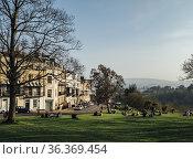 People enjoying the sunshine on the green space of SIon Hill alongside... Стоковое фото, фотограф Mehul Patel / age Fotostock / Фотобанк Лори
