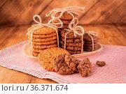Homemade corded wholegrain cookies with oatmeal, linen and sesame... Стоковое фото, фотограф Zoonar.com/BASHTA / easy Fotostock / Фотобанк Лори