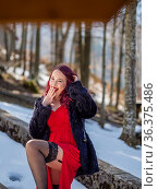 Young woman is fanciful in nature Winter season and snow smiling ... Стоковое фото, фотограф Emil Pozar / age Fotostock / Фотобанк Лори