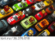 Traffic jam of toy cars carrying holiday gifts or black friday sale... Стоковое фото, фотограф Zoonar.com/Mikhailova Liubov / easy Fotostock / Фотобанк Лори