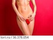 Beautiful woman naked body with red flower between legs. studio shot... Стоковое фото, фотограф Zoonar.com/Svetlana Mandrikova (@Svetography) / easy Fotostock / Фотобанк Лори