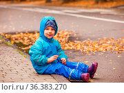 Cute little boy on a walk in a rainy weather in autumn. Happy child... Стоковое фото, фотограф Zoonar.com/Oksana Shufrych / easy Fotostock / Фотобанк Лори