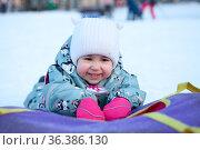 Smiling and laughing baby with snowing tube, portrait. Стоковое фото, фотограф Кекяляйнен Андрей / Фотобанк Лори