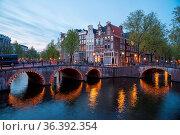 Beautiful night in Amsterdam. Night illumination of buildings and... Стоковое фото, фотограф Zoonar.com/Yuri Dmitrienko / easy Fotostock / Фотобанк Лори