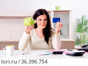 Young woman with receipts in budget planning concept. Стоковое фото, фотограф Zoonar.com/Elnur Amikishiyev / easy Fotostock / Фотобанк Лори