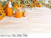 Hippophae homemade sea buckthorn oil in glass bottles with a pipette on the background with copy space, alternative herbal medicine and cosmetology. Стоковое фото, фотограф Светлана Евграфова / Фотобанк Лори