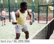 Two padel tennis players play in court. Стоковое фото, фотограф Яков Филимонов / Фотобанк Лори