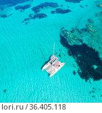 Drone aerial view of catamaran sailing boat in Maddalena Archipelago... Стоковое фото, фотограф Zoonar.com/Matej Kastelic / easy Fotostock / Фотобанк Лори