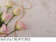 Wedding postcard. Eustoma flowers, delicate veil and beads on light background. Стоковое фото, фотограф Сергей Молодиков / Фотобанк Лори