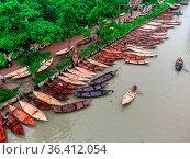 BARISHAL, BANGLADESH- AUGUST 18, 2021: Aerial views of a boat manufacturers... Редакционное фото, фотограф Eyepix / WENN / age Fotostock / Фотобанк Лори