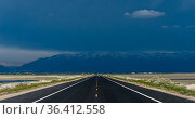 Straight road going towards a very stormy and black sky with the ... Стоковое фото, фотограф Marquicio Pagola / age Fotostock / Фотобанк Лори