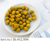 Plate with pickled whole olives on dining table. Стоковое фото, фотограф Яков Филимонов / Фотобанк Лори