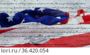 Written constitution of the United States and flag with military tag 4k. Стоковое фото, агентство Wavebreak Media / Фотобанк Лори