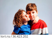 The little girl with curly hair hugs her brother tightly. The children... Стоковое фото, фотограф Zoonar.com/OKSANA SHUFRYCH / easy Fotostock / Фотобанк Лори