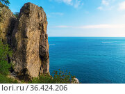 A steep cliff near the Golitsyn trail .Crimea, the New World. Стоковое фото, фотограф Алексей Маринченко / Фотобанк Лори