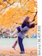 Love, relationship, family and people concept - couple with maple... Стоковое фото, фотограф Zoonar.com/Tatiana Badaeva / easy Fotostock / Фотобанк Лори