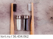 Zero waste self-care products. Black, white bamboo toothbrushe, and... Стоковое фото, фотограф Zoonar.com/Oksana Shufrych / easy Fotostock / Фотобанк Лори