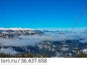 Slovak ski resort in Jasna. Blue sky and light fog between the mountain... Стоковое фото, фотограф Zoonar.com/Mikhail Pavlov / easy Fotostock / Фотобанк Лори